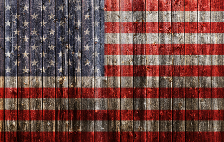 American flag painted on old wood plank background