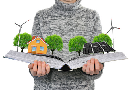 renewable energy: Ecological book in hand. Clean energy concept. Stock Photo