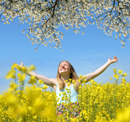 woman young: Young happy woman on blooming rapeseed field in spring