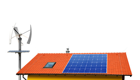 alternativ: Solar panel on the roof of the house in the background wind turbines.