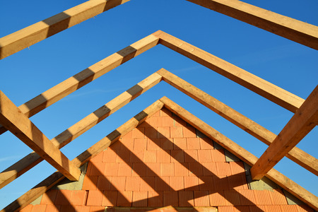treated board: Roof frame rafters. Building a new house. Stock Photo