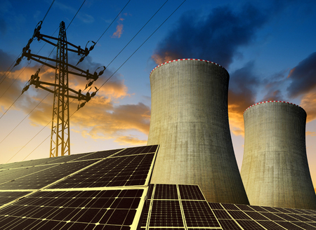 alternativ: Solar energy panels, nuclear power plant and electricity pylon at sunset.