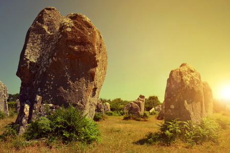 megaliths: Megalithic monuments menhirs in Carnac at sunset ,Brittany ,France Stock Photo