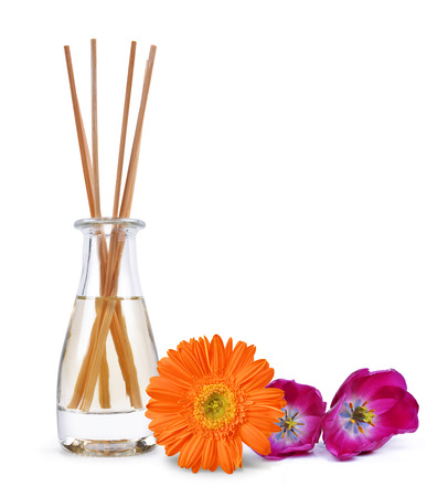 aroma: Air freshener with wooden aroma sticks and flowers isolated on white background