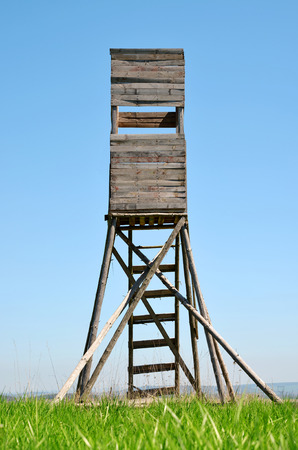 lookout: Lookout tower for hunting on meadow. Stock Photo