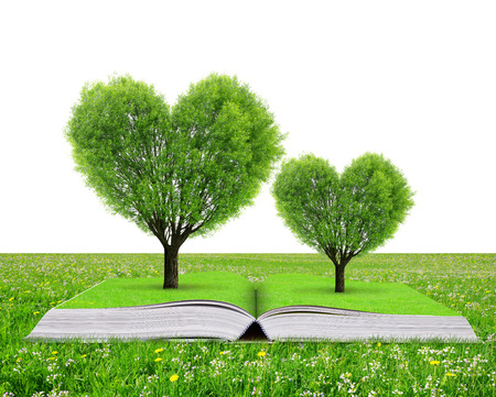 Book with a trees in the shape of heart in grass