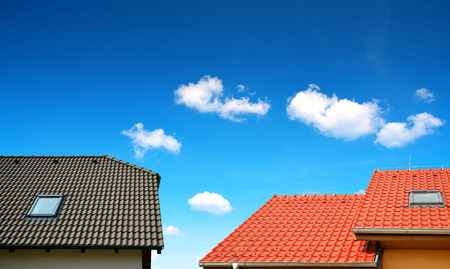 tiled: Roof house with tiled roof on blue sky.