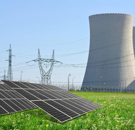 alternativ: Solar energy panels before a nuclear power plant Stock Photo