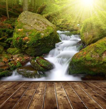 nant: Beautiful waterfall with wooden planks Stock Photo