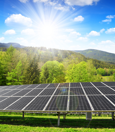 Solar panels in spring landscape. Concept of clean energy.