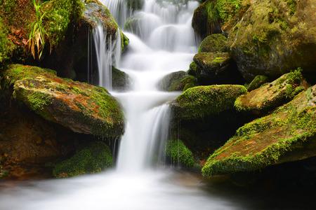 nant: Waterfall on a mountain creek. Stock Photo
