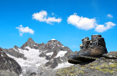 hiking shoes: Hiking shoes on the rock, in the background mount Gabelhorn - Pennine Alps, Switzerland