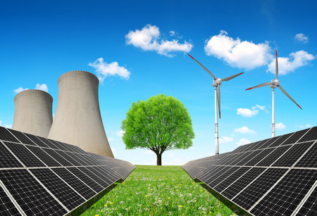 alternativ: Solar panels before a nuclear power plant and wind turbines. Energy resources concept.