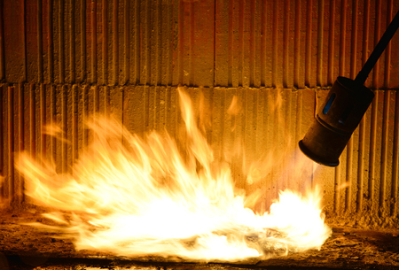 blowtorch: Installation of roll waterproofing propane blowtorch. Melting insulation material. Stock Photo