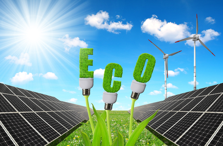 sustainable resources: Solar panels with lightbulbs on plant against sunny sky. The concept of sustainable resources. Stock Photo