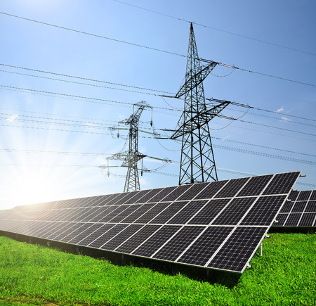 alternativ: Solar panels with electricity pylons. Concept of sustainable resources. Stock Photo