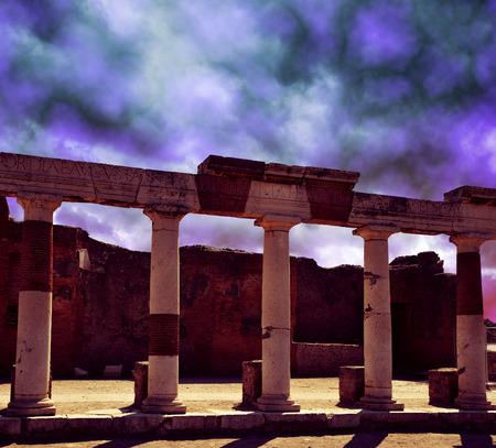 dark city: Ancient Roman city of Pompeii with dark storm clouds, Italy.