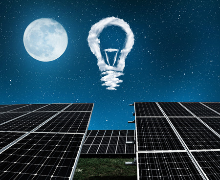 alternativ: Solar panels with lightbulbs from clouds in night . The concept of sustainable resources
