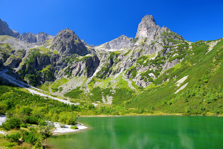 Beautiful summer landscape. Mountain lake Zelene pleso in National Park High Tatra. Slovakia, Europe.