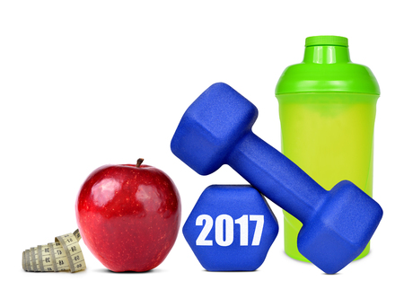 fit: Red apple, dumbbells and protein shaker isolated on white. Healthy resolutions for the New Year 2017
