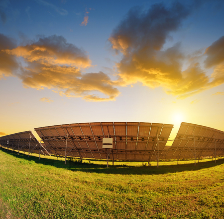 photovoltaic power station: Photovoltaic panels at sunset. Power plant using renewable solar energy. Stock Photo