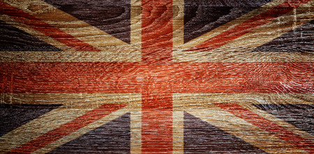 British flag on wood texture background.