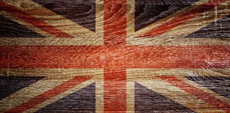 british: British flag on wood texture background.