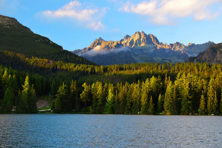 summer nature: Mountain lake Strbske pleso in National Park High Tatras at sunset, Slovakia, Europe