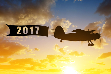 aircraft: Engine airplane flying at sunset. Concept of New Year 2017