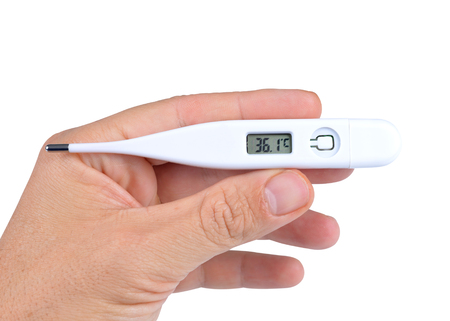 Human hand holding electric digital thermometer on white background Stock Photo