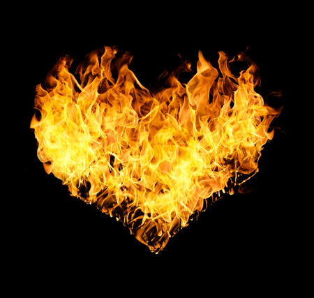Fires flames in heart shape isolated on black background.