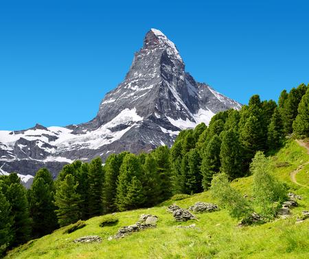 Beautiful mountain landscape with views of the Matterhorn peak in Pennine alps, Switzerland. Stock Photo