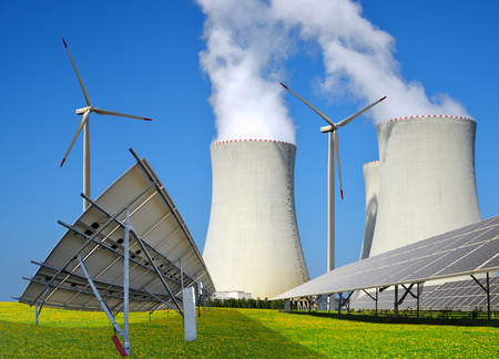 Solar panels, wind turbines and nuclear power plant. Energy resources concept.