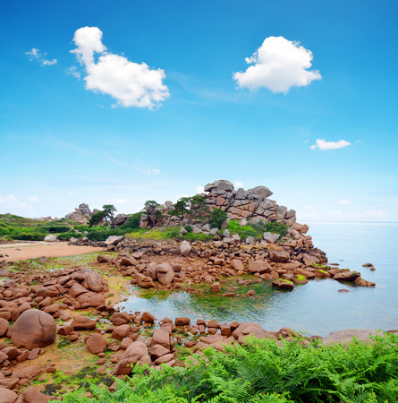pink skies: Ploumanach, Pink Granite Coast in Brittany, France Stock Photo