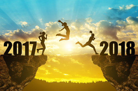 Girls jump to the New Year 2018 at sunset.