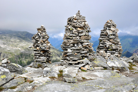 Big stones cairns near mountain top Medelzkogel in National park Hohe Tauern, Austria.