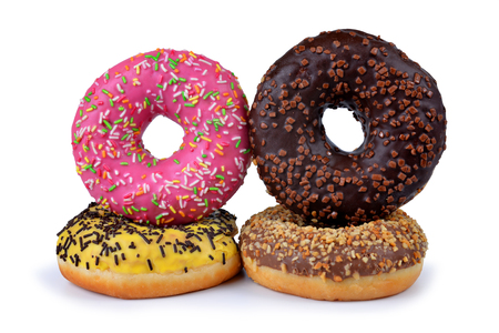 sweet pastries: Donuts with colorful sugar icing isolated on white background. Sweet delicious pastries for breakfast.