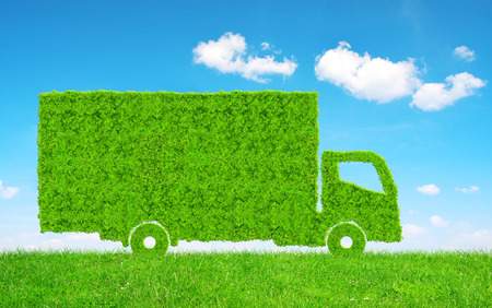 Green Truck in grass. Concept of ecology transport. Stock Photo