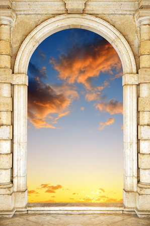 stone of destiny: Old gate at dramatic sunset sky. Door to Heaven.