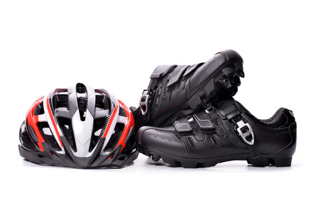 Mountain bike cycling shoes and helmet isolated on white background.