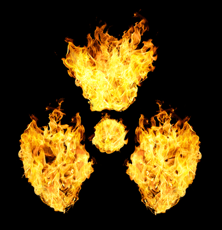 irradiation: Nuclear symbol from fire flames isolated on black background. Stock Photo