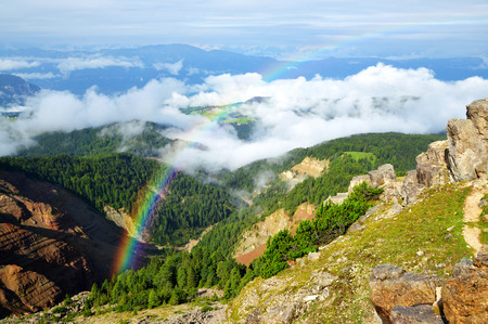 Rainbow above the Bletterbach canyon in Dolomites. South Tyrol, Italy.