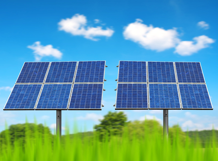 Solar panels on the meadow. Photovoltaic power plant generate clean energy. Environmental protection theme. Stock Photo