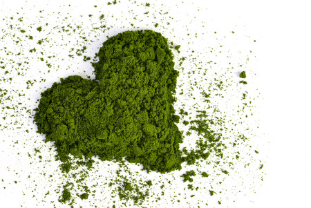 Heart from young barley or wheat grass isolated on white background. Detox superfood. Foto de archivo