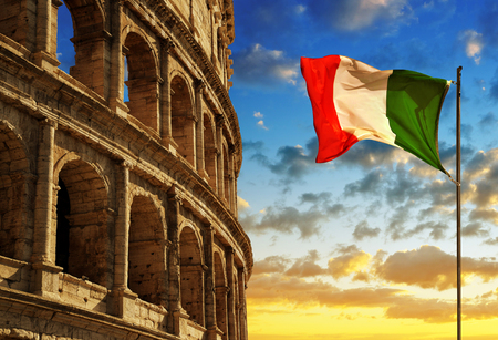 Italian flag with Flavian Amphitheatre or Colosseum at sunset. Rome, Italy Stock Photo