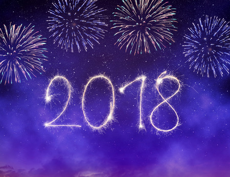 Fireworks in the night sky. Celebrating the New Year 2018.