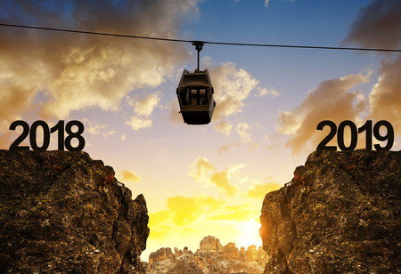 New Year 2019 concept. The mountain cable car moving above the abyss at sunset.