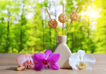 Air freshener with orchid flowers on table.Spa and healthcare concept. Reklamní fotografie