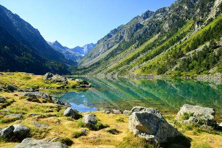 View of the Gaube lake in summer with mount Vignemale in the background.Pyrenees mountain, France. Stock Photo