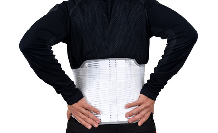 Man wearing back support belt isolated on white.